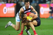 Christian Salem of the Demons is tackled by Jack Henry of the Cats  during the round 18 AFL match between the Geelong Cats and the Melbourne Demons at GMHBA Stadium on July 21, 2018 in Geelong, Australia.