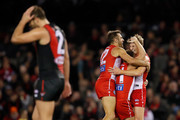 Jordan Dawson of the Swans (right) celebrates his first AFL goal with Josh Kennedy (left) and Tom Papley of the Swans during the 2018 AFL round 19 match between the Essendon Bombers and the Sydney Swans at Etihad Stadium on July 27, 2018 in Melbourne, Australia.