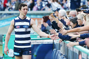 Jack Henry of the Cats celebrates the win with fans during the round 19 AFL match between the Geelong Cats and the Brisbane Lions at GMHBA Stadium on July 28, 2018 in Geelong, Australia.