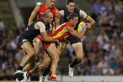 Daniel Harris of the Suns is tackled by Chris Judd of the Blues during the round two AFL match between the Gold Coast Suns and the Carlton Blues at The Gabba on April 2, 2011 in Brisbane, Australia.