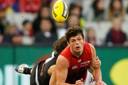 Angus Brayshaw of the Demons is tackled by Dylan Buckley of the Blues during the 2015 AFL round 21 match between the Carlton Blues and the Melbourne Demons at the Melbourne Cricket Ground, Melbourne, Australia on August 23, 2015.