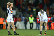 Rory Sloane and Bryce Gibbs of the Crows look dejected after the round 21 AFL match between the Greater Western Giants and the Adelaide Crows at UNSW Canberra Oval on August 11, 2018 in Canberra, Australia.