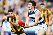 Jack Henry of the Cats handballs during the round 21 AFL match between the Hawthorn Hawks and the Geelong Cats at Melbourne Cricket Ground on August 11, 2018 in Melbourne, Australia.