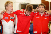 (L-R) Isaac Heeney of the Swans, Alex Johnson of the Swans and Nick Smith of the Swans sing the team song during the 2018 AFL round 21 match between the Melbourne Demons and the Sydney Swans at the Melbourne Cricket Ground on August 12, 2018 in Melbourne, Australia.