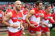 Jarrad McVeigh, Josh Kennedy and Luke Parker of the Swans run out during the round 21 AFL match between the Sydney Swans and the St Kilda Saints at Sydney Cricket Ground on August 16, 2014 in Sydney, Australia.