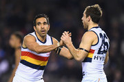 Eddie Betts and Richard Douglas of the Crows celebrate a goal during the round 23 AFL match between the Carlton Blues and the Adelaide Crows at Etihad Stadium on August 25, 2018 in Melbourne, Australia.
