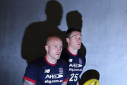 Nathan Jones (L) and Tom McDonald of the Demons walk out for warm up during the round 23 AFL match between the North Melbourne Kangaroos and the Melbourne Demons at Etihad Stadium on August 30, 2014 in Melbourne, Australia.