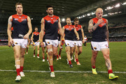 Tom McDonald (L) Chris Dawes (C) and Nathan Jones of the Demons walk off after their defeat during the round 23 AFL match between the North Melbourne Kangaroos and the Melbourne Demons at Etihad Stadium on August 30, 2014 in Melbourne, Australia.