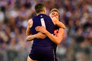 Hayden Ballantyne and Tom Sheridan of the Dockers celebrates a goal during the 2018 AFL round 03 match between the Gold Coast Suns and the Fremantle Dockers at Optus Stadium on April 7, 2018 in Perth, Australia.