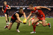 Tom Bellchambers of the Bombers competes with Daniel Harris of the Suns during the round six AFL match between the Essendon Bombers and the Gold Coast Suns at Etihad Stadium on May 1, 2011 in Melbourne, Australia.