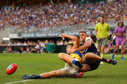 Stephen Hill of the Dockers tackles Elliot Yeo of the Eagles during the Round 6 AFL match between the Fremantle Dockers and West Coast Eagles at Optus Stadium on April 29, 2018 in Perth, Australia.