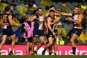 Dom Sheed, Luke Shuey, Josh Kennedy and Fraser McInnes of the West Coast Eagles celebrate a goal during the round seven AFL match between the West Coast Eagles and the Gold Coast Suns at Domain Stadium on May 16, 2015 in Perth, Australia.