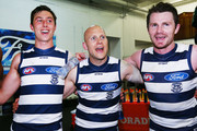 Jack Henry (L) Gary Ablett (C) and Patrick Dangerfield of the Cats sing the club song after winning during the round eight AFL match between the Collingwood Magpies and the Geelong Cats at Melbourne Cricket Ground on May 13, 2018 in Melbourne, Australia.