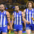 Ben Cunnington, Jamie Macmillan and Ben Brown of the Kangaroos look dejected after losing the round eight AFL match between the North Melbourne Kangaroos and the Richmond Tigers at Etihad Stadium on May 13, 2018 in Melbourne, Australia.