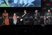 (L-R) Danai Gurira, Cailey Fleming, Josh McDermitt, Seth Gilliam, and Ross Marquand speak onstage during a panel for AMC's The Walking Dead Universe including AMC's flagship series and the untitled new third series within The Walking Dead franchise at Hulu Theater at Madison Square Garden on October 05, 2019 in New York City.