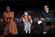(L-R) Danai Gurira, Cailey Fleming and Josh McDermitt speak onstage during a panel for AMC's The Walking Dead Universe including AMC's flagship series and the untitled new third series within The Walking Dead franchise at Hulu Theater at Madison Square Garden on October 05, 2019 in New York City.