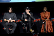 (L-R) Norman Reedus, Jeffrey Dean Morgan, and Danai Gurira speak onstage during a panel for AMC's The Walking Dead Universe including AMC's flagship series and the untitled new third series within The Walking Dead franchise at Hulu Theater at Madison Square Garden on October 05, 2019 in New York City.