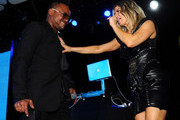 Apl.de.Ap (L) and singer Fergie of the Black Eyed Peas perform at APL.De.Ap's Birthday Celebration and Launch of Charity Dreams at The Conga Room at L.A. Live on December 13, 2011 in Los Angeles, California.