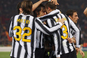 Giorgio Chiellini (R) of Juventus celebrates his penalty equaliser with Andrea Pirlo, Alessandro Matri and team-mates during the Serie A match between AS Roma and Juventus FC at Stadio Olimpico on December 12, 2011 in Rome, Italy.