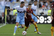 Adam Marusic of SS Lazio compete for the ball with Stephan El Shaarawy of AS Roma during the Serie A match between AS Roma and SS Lazio at Stadio Olimpico on September 29, 2018 in Rome, Italy.