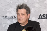 Designer and host Isaac Mizrahi poses with a puppy during the 21st Annual Bergh Ball hosted by the ASPCA at The Plaza Hotel on April 19, 2018 in New York City.