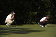 Bernhard Langer (L) of Germany and Chip Beck aims for a putt on the 17th hole during the final round of the PGA Champions Tour AT&T Championship at the Oak Hills Country Club on October 25, 2009 in San Antonio, Texas.