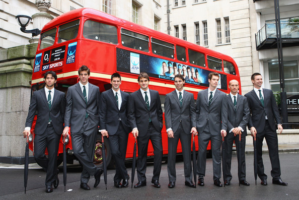 (L-R) Fernando Verdasco of Spain, Juan Martin Del Potro of Argentina, Novak Djokovic of Serbia, Roger Federer of Switzerland, Rafael Nadal of Spain, Andy Murray of Great Britain, Nikolay Davydenko of Russia and Robin Soderling of Sweden pose with umbrellas in front of a London Bus during the Barclays ATP World Tour Finals - Media Day at the County Hall Marriot Hotel on November 20, 2009 in London, England.
