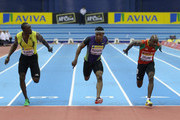 Michael Rodgers of USA (C) wins in the 60m final against (L) Marc Burns of Trinidad and Tobago and Kim Collins of Saint Kitts and Nevis during the AVIVA Grand Prix Indoor Athletics on February 19, 2011 in Birmingham, England.