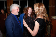 """(L-R) Filmmaker Pedro Almodovar, actress Julianne Moore and AMPAS CEO Dawn Hudson attend The Academy of Motion Picture Arts and Sciences """"2019 New Members Party"""" at the Top of the Standard in New York on October 1, 2019 in New York City."""