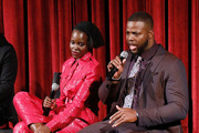 Actors Lupita Nyong'o and Winston Duke on stage during The Academy of Motion Picture Arts and Sciences official screening of Us at the MoMA Celeste Bartos Theater on March 18, 2019 in New York City.