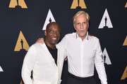 """John Singleton and Randal Kleiser attend the Academy Presents """"Grease"""" (1978) 40th Anniversary at the Samuel Goldwyn Theater on August 15, 2018 in Beverly Hills, California."""