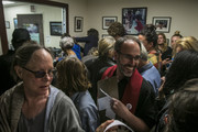 Protestors gather in Sen. Susan Collins' office to urge Sen. Collins to vote no on the confirmation of Supreme Court nominee Brett Kavanaugh on September 28, 2018 in Portland, Maine.  At center is Rev. Allen Ewing-Merrill. Sen. Jeff Flake (R-AZ) was crucial in getting the committee to agree to an additional week of investigations into accusations of sexual assault against Kavanaugh before the full Senate votes. A day earlier the committee heard from Kavanaugh and Christine Blasey Ford, a California professor who has accused Kavnaugh of sexually assaulting her during a party in 1982 when they were high school students in suburban Maryland.