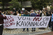 Protestors gather across the street from Sen. Susan Collins' office to urge Sen. Collins to vote no on the confirmation of Supreme Court nominee Brett Kavanaugh on September 28, 2018 in Portland, Maine. Sen. Jeff Flake (R-AZ) was crucial in getting the committee to agree to an additional week of investigations into accusations of sexual assault against Kavanaugh before the full Senate votes. A day earlier the committee heard from Kavanaugh and Christine Blasey Ford, a California professor who has accused Kavnaugh of sexually assaulting her during a party in 1982 when they were high school students in suburban Maryland.