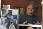 """Actor, comedian and writer John Di Domenico is reflected in a mirror as he changes from U.S. president Donald Trump into the Dr. Evil character from the """"Austin Powers"""" film series at his home amid the spread of the coronavirus on May 7, 2020 in Henderson, Nevada. Di Domenico is creating online video content at home including about 600 videos for the Cameo personalized message website since joining the service in October. He is currently recording 12 to 15 clips every day as demand for his videos has increased during the COVID-19 shutdown. Di Domenico is most requested as Trump but also portrays others such as Guy Fieri, Dr. Phil McGraw, and the Mike Myers character Austin Powers. The World Health Organization declared the coronavirus (COVID-19) a pandemic on March 11th."""