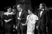 """Image has been converted to black and white.) (R-L) Liv Tyler, Director James Gray, Ruth Negga and Brad Pitt walk the red carpet ahead of the """"Ad Astra"""" screening  during the 76th Venice Film Festival at Sala Grande on August 29, 2019 in Venice, Italy."""