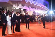 """Image has been created using a starburst filter.) (R-L) Liv Tyler, Director James Gray, Ruth Negga and Brad Pitt walk the red carpet ahead of the """"Ad Astra"""" screening  during the 76th Venice Film Festival at Sala Grande on August 29, 2019 in Venice, Italy."""