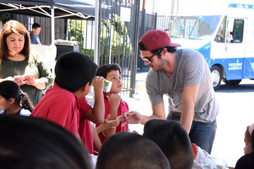 Adam Brody Celebrity Friends Volunteer at Feeding America's Summer Hunger Awareness Event at Para Los Ninos in Los Angeles