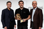 (L-R) Herbert Hainer, the adidas Group CEO, Iker Casillas, adidas Golden Glove Winner and FIFA executive committee member Franz Beckenbauer pose during the FIFA 2010 World Cup adidas Golden Award ceremony at the adidas headquarters on December 14, 2010 in Herzogenaurach, Germany.