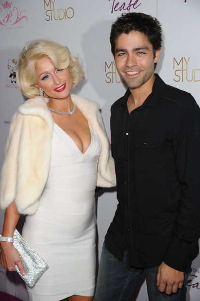 Adrian Grenier Paris Hilton and actor Adrian Grenier arrive to the launch party for Paris Hilton's her new fragrance