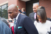 """Adrian Peterson of the Minnesota Vikings and his wife Ashley Brown leave the courthouse after pleading """"no contest"""" to a lesser misdemeanor charge of reckless assault. Peterson's plea to the Class A misdemeanor comes with two years of deferred adjudication. Peterson also received a $4,000 fine and 80 hours of required community service. for a hearing at the Montgomery County Courthouse on November 4, 2014 in Conroe, Texas."""