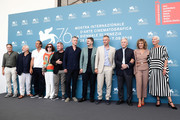 (L-R) Francesco Acquaroli, Vincent Nemeth, Alexandre Desplat, Michèle Ray-Gavras, Cornelius Obonya, Daan Schuurmans, Alexandros Bourdoumis, Christos Loulis, Director Costa-Gavras, Valeria Golino and Josiane Pinson attend 'Adults In The Room' photocall during the 76th Venice Film Festival at Sala Grande on August 31, 2019 in Venice, Italy.