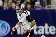 Trevor Knight #8 of the Texas A&M Aggies scrambles with the ball against the Kansas State Wildcats during the AdvoCare V100 Texas Bowl on December 28, 2016 in Houston, Texas.