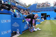 Sabine Lisicki of Germany changes her shoes ahead of her quarter final match over Daniela Hantuchova of Slovakia on day five of the Aegon Classic at Edgbaston Priory Club on June 19, 2015 in Birmingham, England.