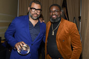 (L-R) Jordan Peele and Lil Rel Howery pose for portrait at The African American Film Critics Association's 11th Annual AAFCA Awards at Taglyan Cultural Complex on January 22, 2020 in Hollywood, California.