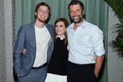 """Caleb Freundlich, Julianne Moore and director Bart Freundlich,  attend the """"After The Wedding"""" New York Screening  After Party at Hotel 50 Bowery Rooftop on August 06, 2019 in New York City."""