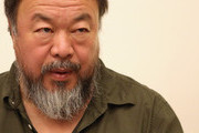 Chinese dissident artist Ai Weiwei pauses as he signs books for fans after a panel discussion at the Berlin International Literature Festival on September 2, 2015 in Berlin, Germany. Ai and poet Liao Yiwu participated in a conversation about literature, contemporary art, and their relationships with Chinese authorities. Liao had been imprisoned for four years in 1989, and in 2011, Ai was detained and beaten by security officials and then imprisoned for 81 days, only to reclaim his passport this past July, after which he went to Germany to meet his his partner Wang Fen and their son Ai Lao.