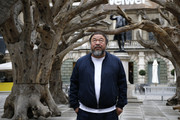 Ai Weiwei stands with his sculpture 'Tree' as he previews works from His landmark art exhibition at the Royal Academy of Arts on September 15, 2015 in London, England. The Royal Academy of Art is showing the work of one of China's leading contemporary artists until mid-December. Ai Weiwei's activism in China saw him detained without charge in 2011 for 81 days.