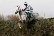 Silver Adonis ridden by Tom Weston clears the last fence on their way to victory in The John Smith's Fox Hunters' Steeple Chase at Aintree Racecourse on April 8, 2010 in Liverpool, England.