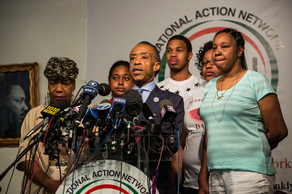 Family of Police Chokehold Death Victim Eric Garner Hold News Conference in NYC [youth,community,team,event,championship,recreation,news conference,competition,competition event,eric garner,erica garner,family,death victim,gwen carr,al sharpton,l-r,nyc,police chokehold,eric garner hold news conference]