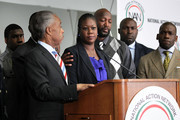 Sybrina Fulton (3rd L), mother of Trayvon Martin who was fatally shot by neighborhood watch captain George Zimmerman in Florida, speaks during a news conference as her husband Tracy Martin (4th L), Trayvon's brother Jahvaris Fulton (L), and President and Founder of National Action Network Rev. Al Sharpton (2nd L) listen April 11, 2012 in Washington, DC.  It has been reported that Zimmerman will be charged in the Trayvon Martin shooting according to Florida special prosecutor Angela Corey.
